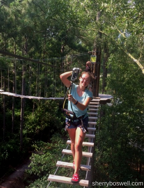 My teen in her harness and attached to the safety line by 2 carabiners. Photo by Sherry Boswell, Melodious TravelingMom.