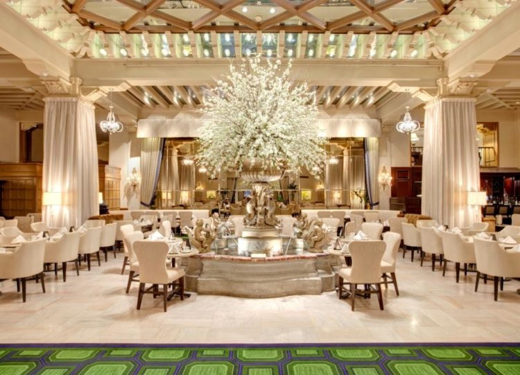 High tea is served in the Palm Court room of the Drake Hotel, one of our favorite family friendly restaurants in Chicago.