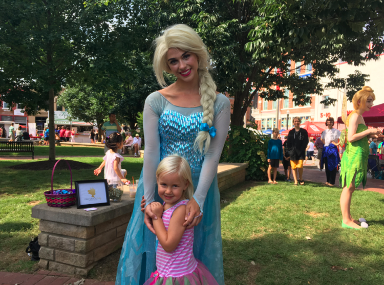 Meeting Elsa at the Farmer's Market in the Square. Photo by Heidi Gollub, Big Family TravelingMom.