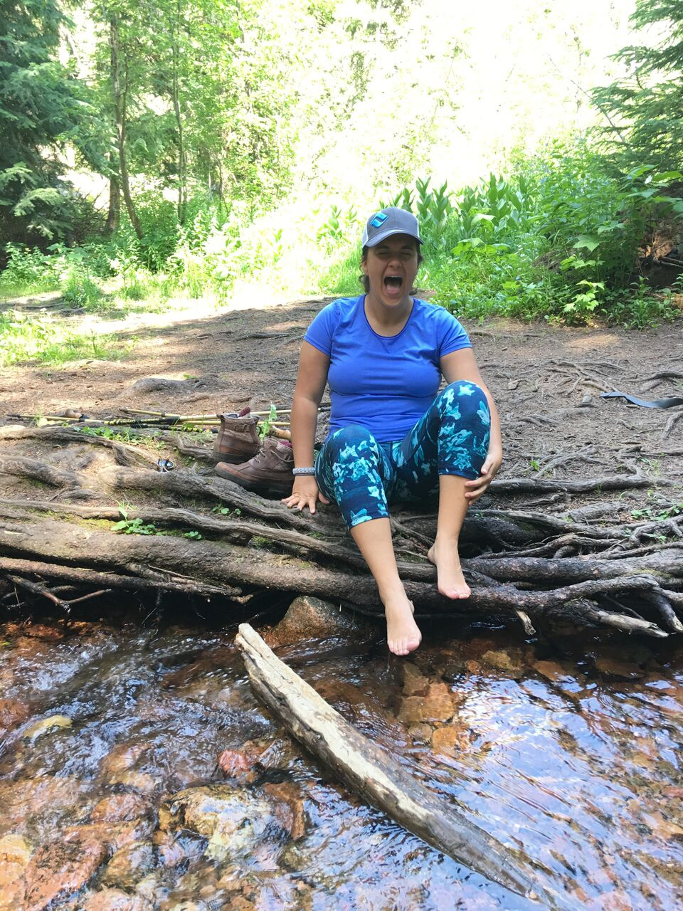 Dipping toes into the cold streams during our Vail family vacation