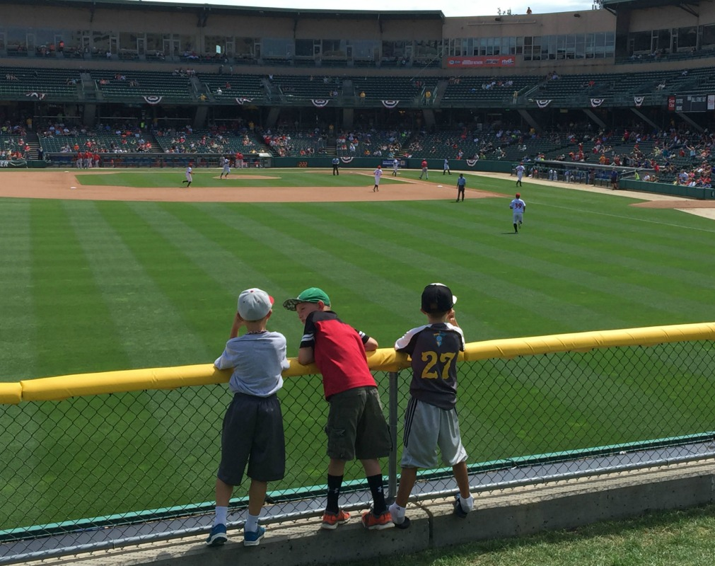 Three boys indulge in a summer rite of passage: a day at the ballpark.