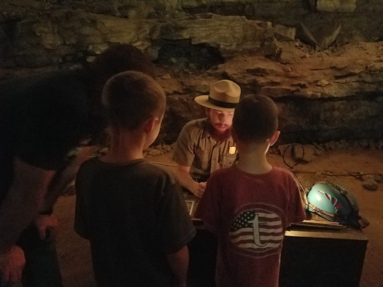 Learning inside the cave. Photo Courtesy: Allison Taylor, Research Traveling Mom