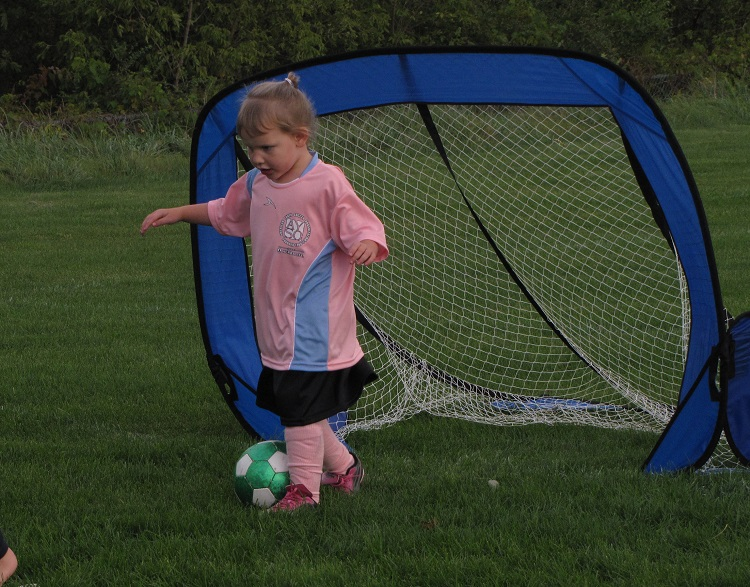 Becca's first season of soccer at age 4. Photo credit: Deb Steenhagen / TravelingMom with Daughters