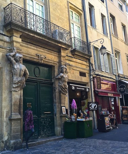 Elegant statues guard the entrance of this mansion in Aix, France