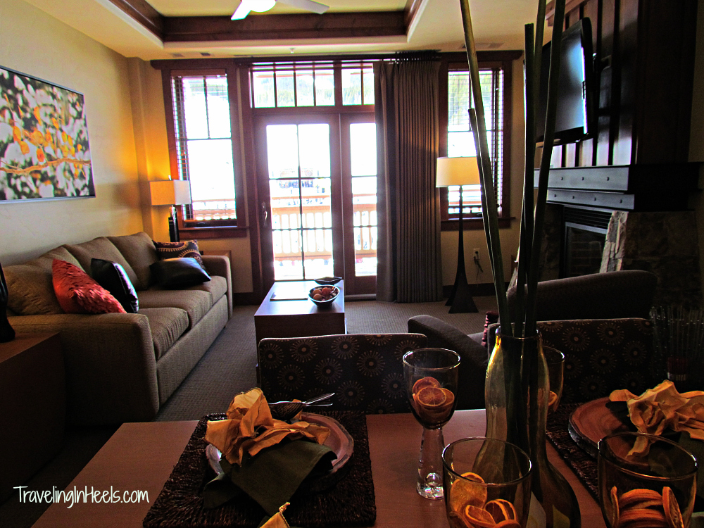 A condo for your family ski vacation should include a living room and a fireplace. Don't you agree?