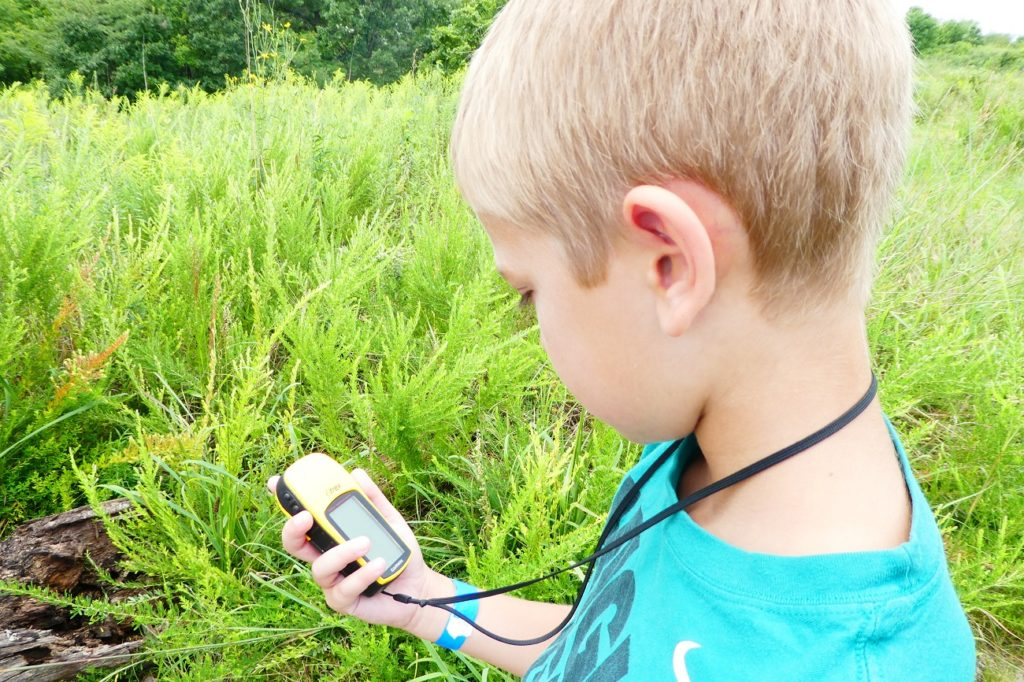 Geocaching is a fun thing for kids do to during nature hikes at Honey Creek Resort in Iowa. Photo by Jamie Bartosch/Suburban TravelingMom