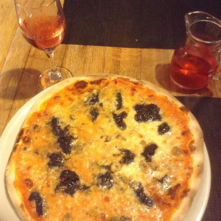 Truffle laced pizza in Cinque Valli smells almost too good to eat. Almost. Photo by Dia Adams