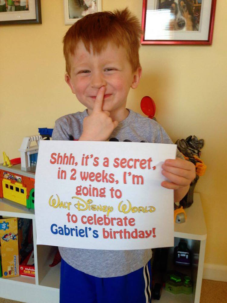 boy shows off his Disney surprise - TravelingMom