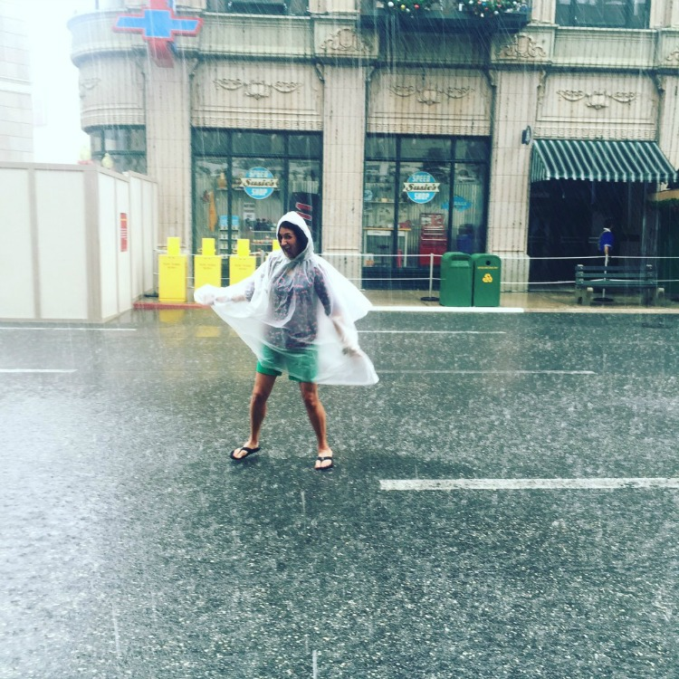 Dancing in the rain at Disney's Hollywood Studios - travel without kids.
