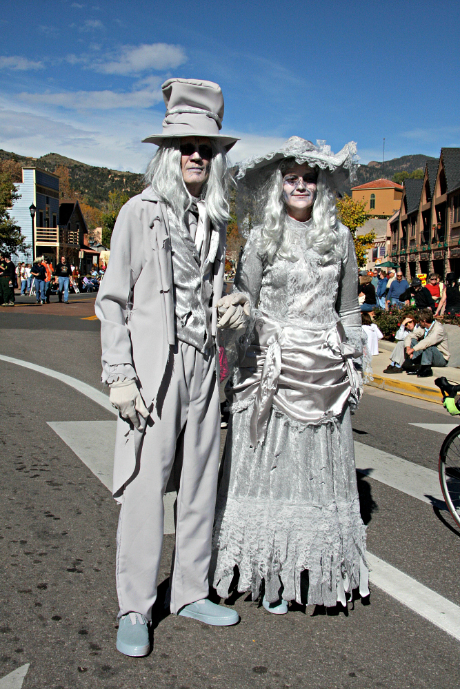 Costumed creatures at the Emma Crawford Coffin Races and Parade in Manitou Springs at Halloween in Colorado