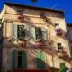 Typical of Arles: brilliant sunlight, ochre buildings with light blue shutters, covered in flowers in