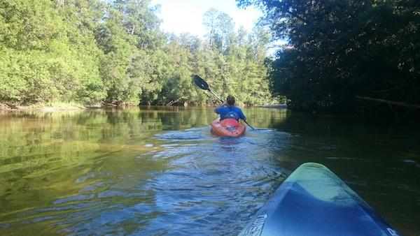 kayaking on a river in Navarre Beach