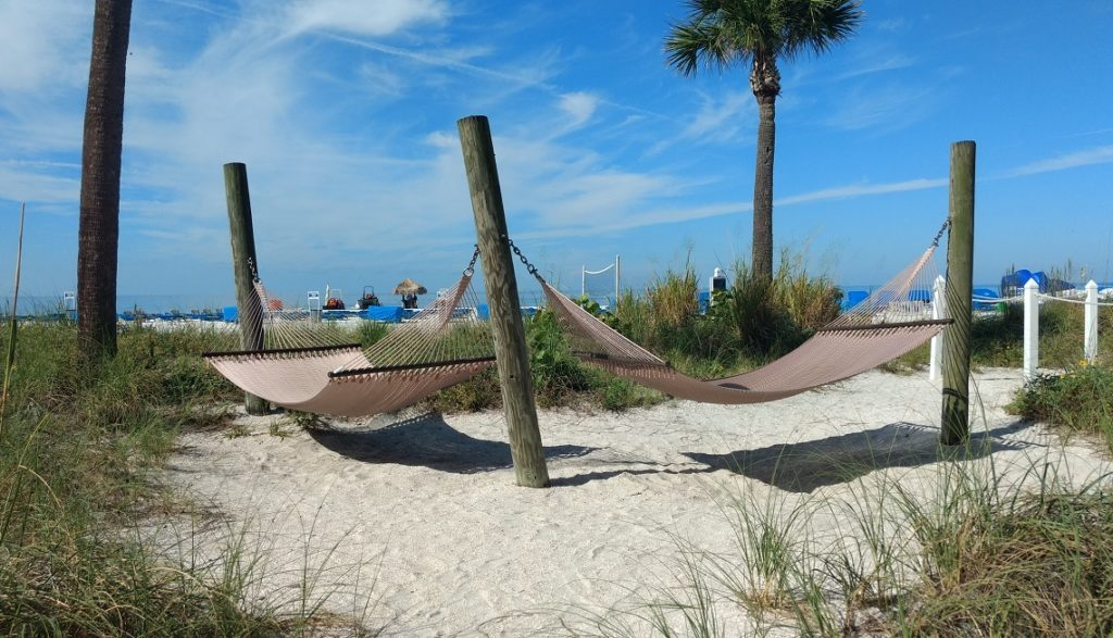 Hammocks on the beach at Tradewinds Island Resort.