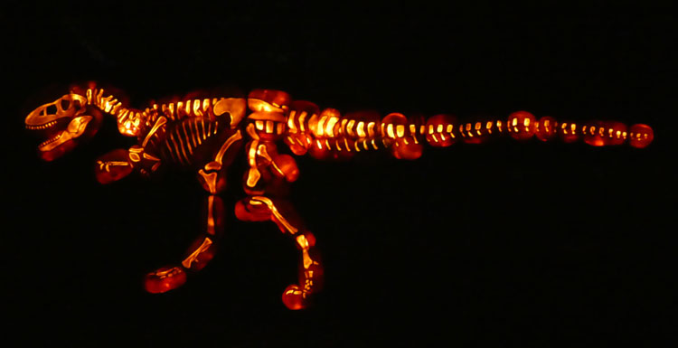 Sixteen-foot tall dinosaurs made from carved pumpkins at THE GLOW NJ.