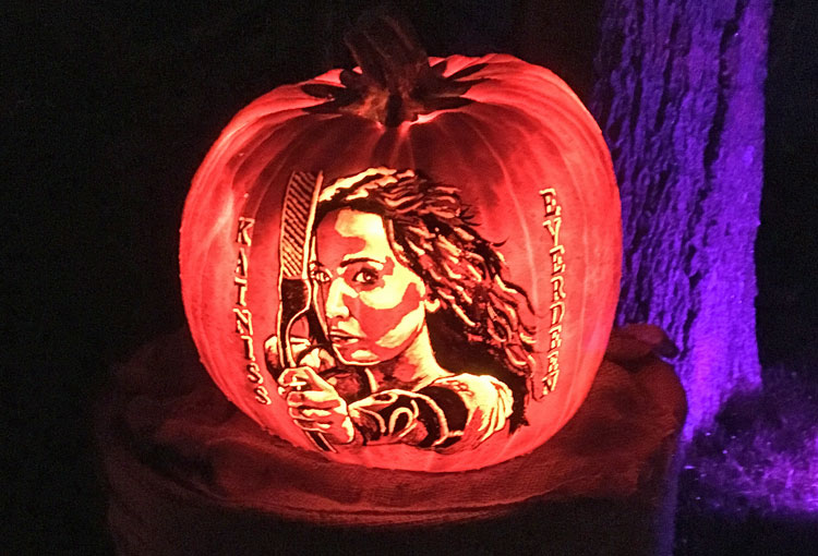 Katniss Everdeen carved into a jack o'lantern.