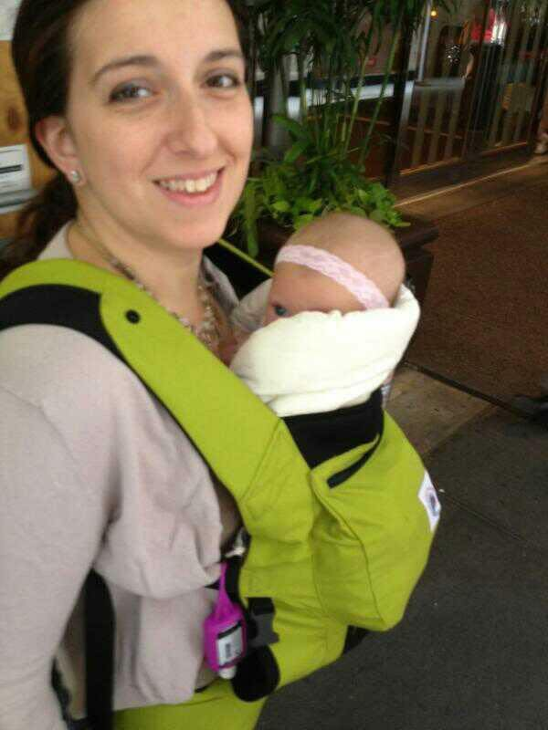 When flying with a baby, babywearing keep babies contained and your hands free.