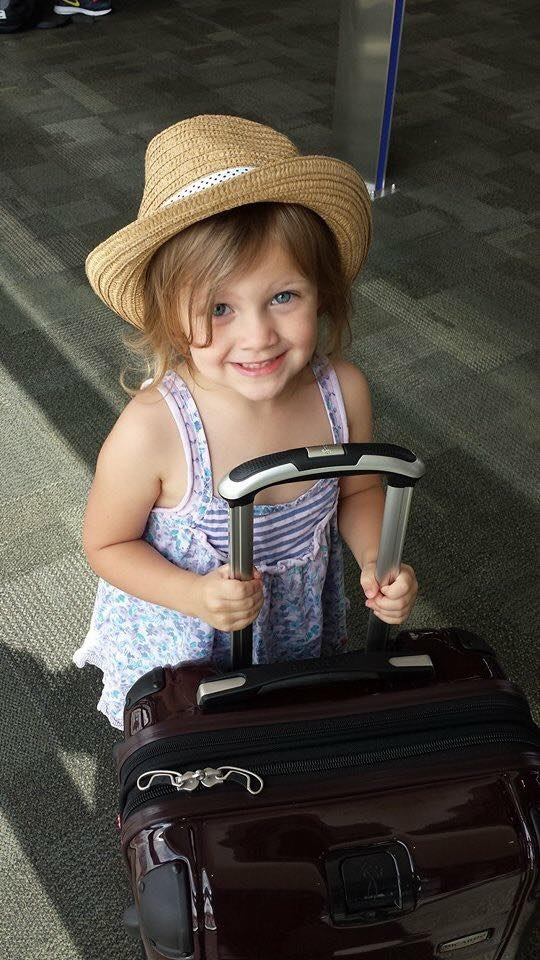 Even kids as young as 4 can push a 4-wheel roller suitcase.
