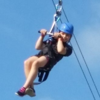Ziplining at Amber Cove: And this is after hiking up and sliding down 12 waterfalls. I want her energy!