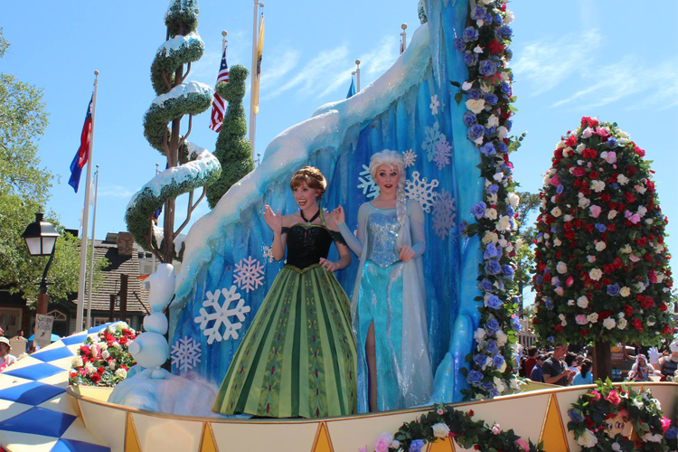Anna and Elsa wave to guests in the Festival of Fantasy Parade. Photo Credit: Sean Day/ Disney Day by Day