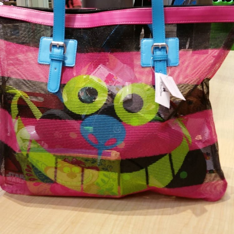 All smiles for this Cheshire Cat bag I picked up for 75% off at the Disney outlet!