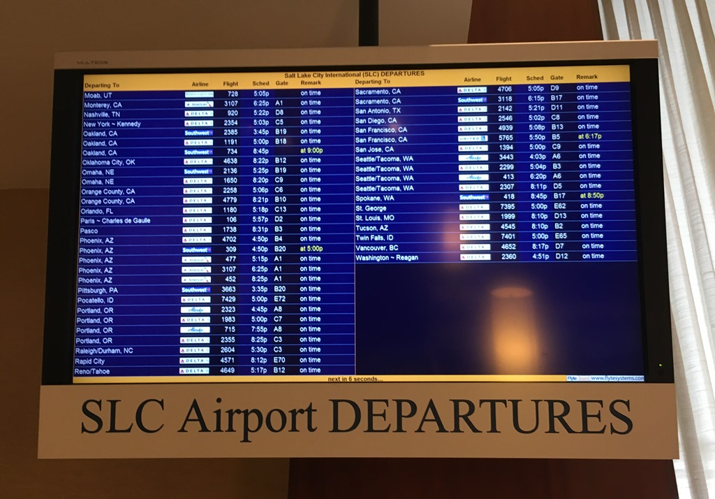 Airport departures board at Hilton Salt Lake City Center.