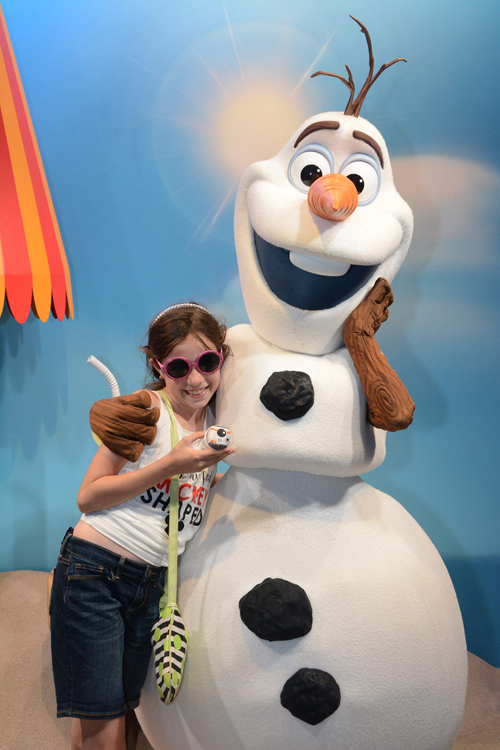 A young fan gives Olaf a warm hug at Disney Hollywood Studios. Find out where to find Olaf's friends Anna & Elsa at Disney World.