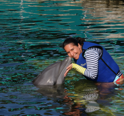 Getting a kiss from a dolphin at Dolphins Plus in Key Largo Florida.