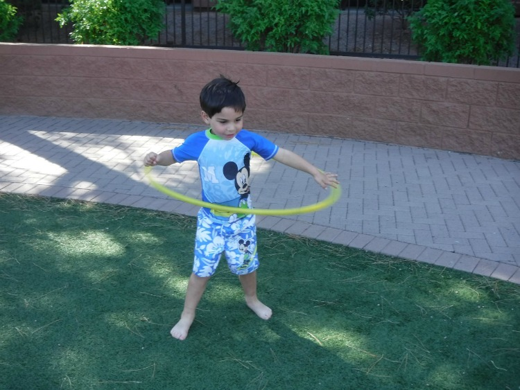 Getting ready for some hula hooping, a kid-friendly activity at the Westin Kierland in Scottsdale, Arizona! Photo by Multidimensional TravelingMom, Kristi Mehes.