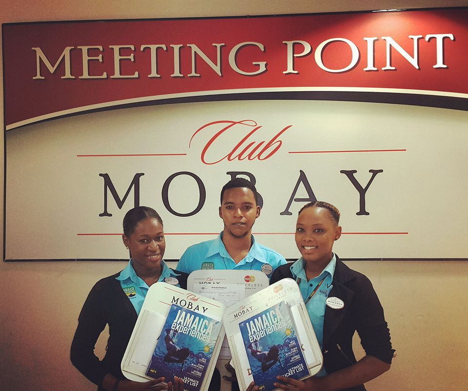 greeting agents at Sangster Airport in Jamaica at the meeting point for club mobay