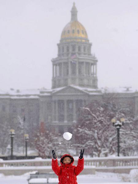 Winters are mild in Denver, and when it snows, we celebrate by making snowballs at the Colorado State Capitol.