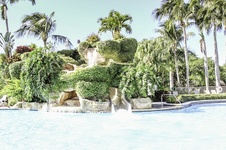 The water slide at The Naples Grande is perfect for family fun by the pool. Photo Credit: Hannah Rinaldi | Fabulously Frugal TravelingMom