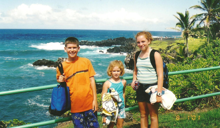 There are plenty of scenic stops at overlooks and waterfalls on Maui's Road to Hana to take family photos.