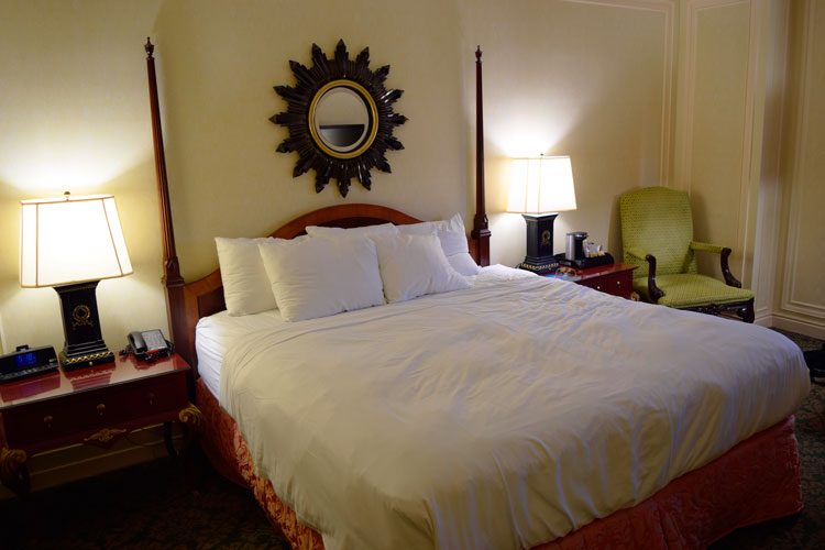 The spacious king bed in the Amway Grand Plaza, an historic hotel in Grand Rapids, Michigan