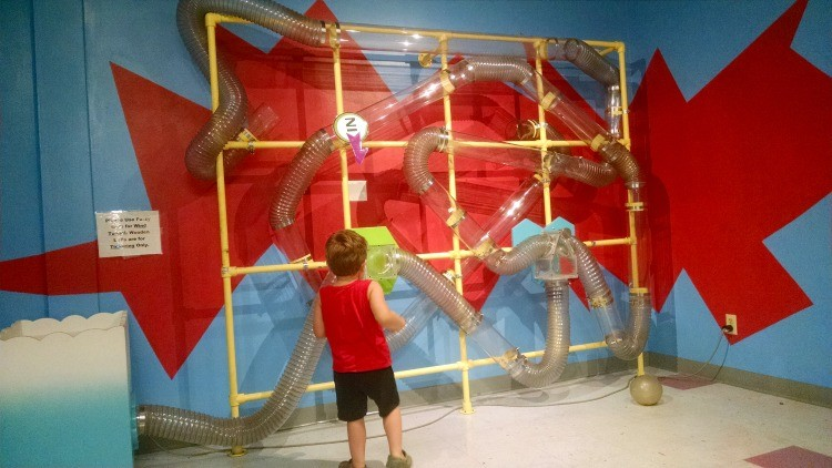 Playing with the air tunnel in the Wonderland toddler room at Discovery Center in Springfield, MO