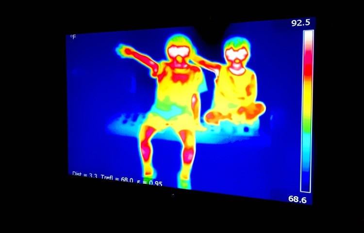 Seeing themselves on a monitor in front of a heat-seeking camera at Discovery Center in Springfield, MO