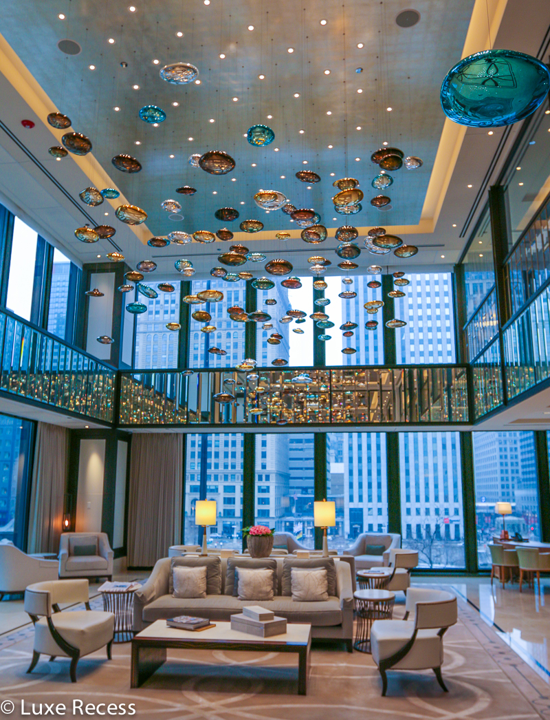 The dazzling design of the Langham Chicago lobby ceiling makes it one of the most romantic hotels in the country.