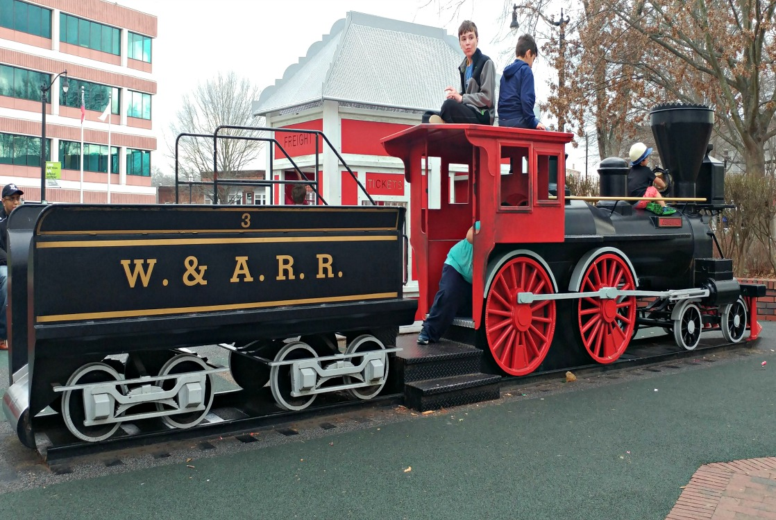 Kids play on a replica of The General, a confederate locomotive stolen by Union raiders during the Civil War. The raid was planned at Kennesaw House located in the Marietta Square.
