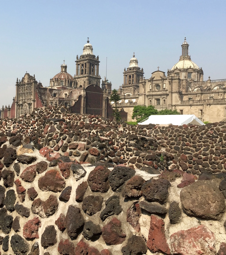 Ancient artifacts merge with skylines fueling Mexico City energies.
