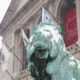Two iconic lions stand in front of the Art Institute of Chicago.