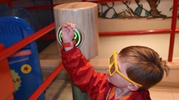 Scanning your MagicBand to access your Fastpass+ selection is simple for even the youngest guest.