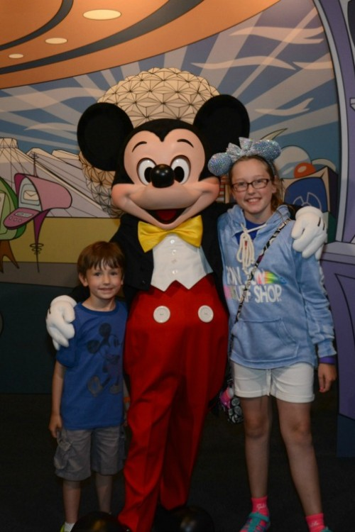 A young boy and girl posing with Mickey at Disney during one day in Epcot.