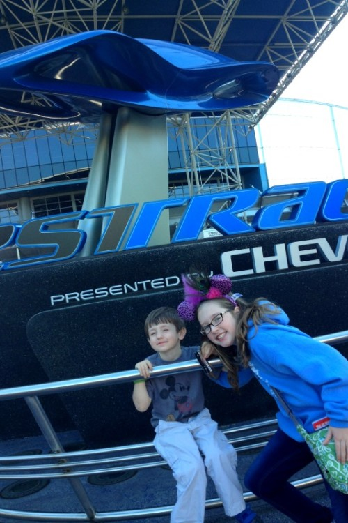 Young boy and girl ready to tackle Test Track at Disney, which you won't want to miss with one day at Epcot Center