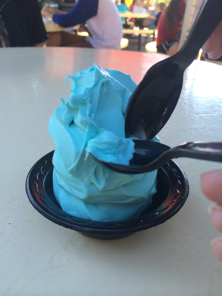 A large cup of blue soft serve ice cream, a fan favorite which often tops locals' lists of Kings Island tips and secrets.