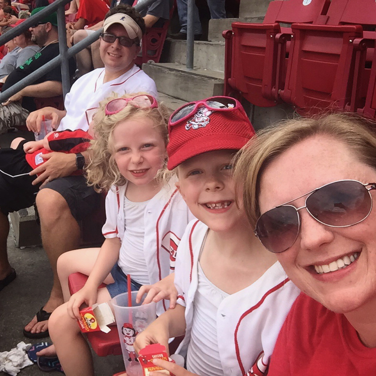 A family enjoys a Reds game in Cincinnati, where baseball is one of the quintessential spring activities