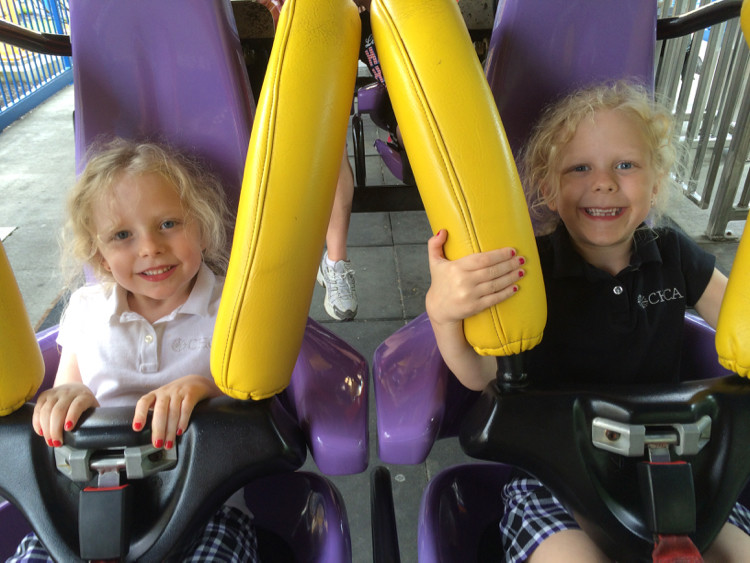 Two young girls are ready to ride a roller coaster in the award-winning kids area at Kings Island