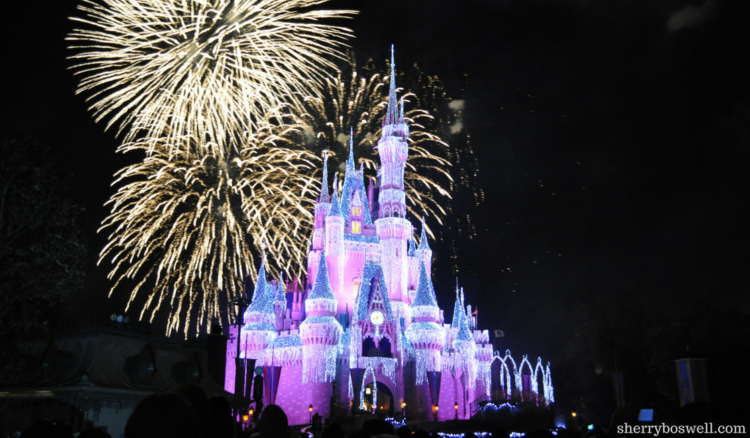 One day at Magic Kingdom touring plan includes viewing the Disney castle at night with fireworks.