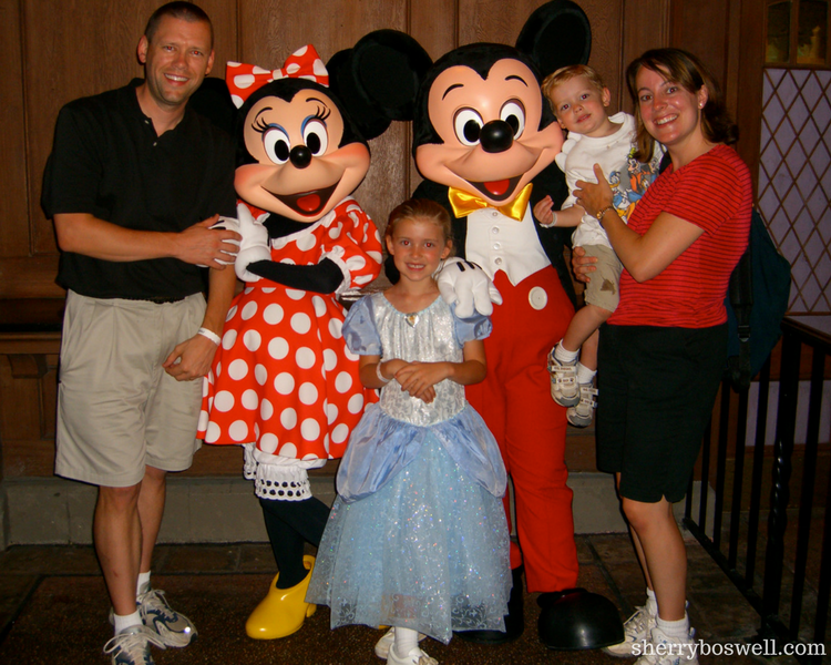 Photo opp with family, Mickey and Minnie during one day at Magic Kingdom touring plan.