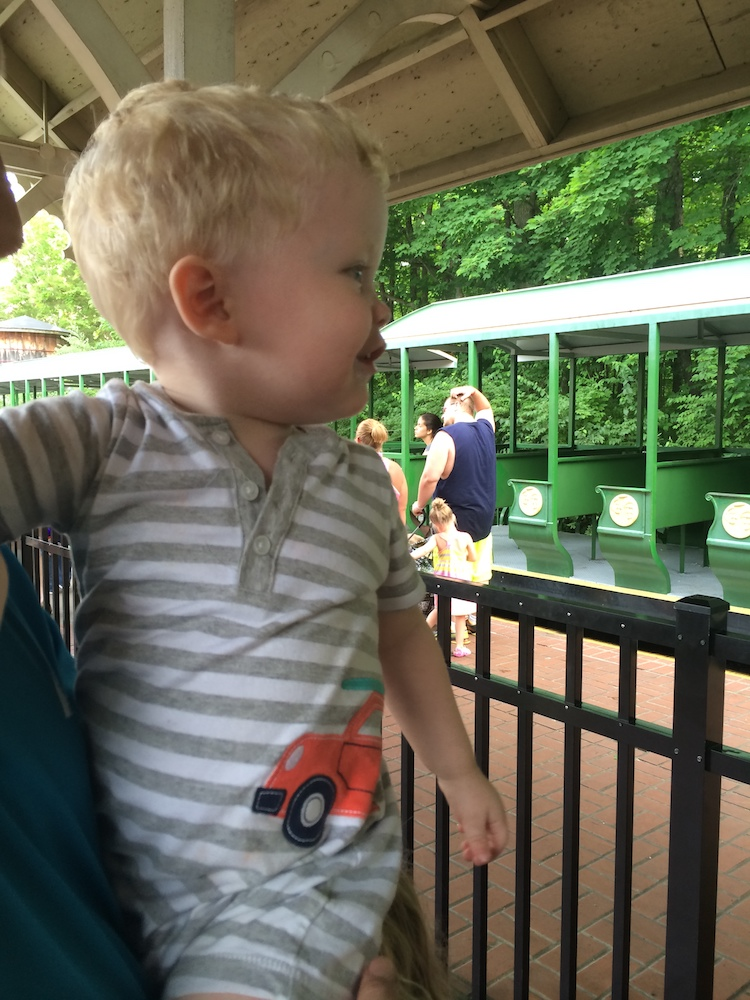 Baby riding the steam train around the park, one of the Kings Island tips to a great visit.