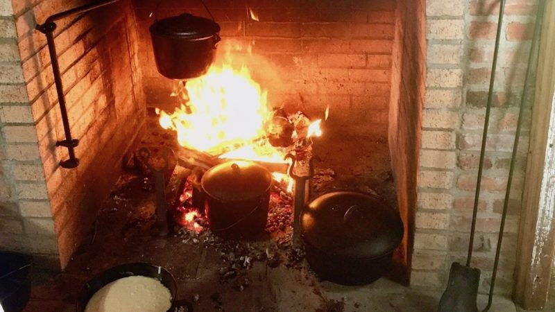 Iron skillet cooking calls for careful movements with hot flames.
