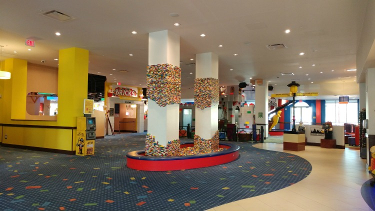 The lobby of the LEGOLAND Florida Resort has several stations to entertain kids through building and play.